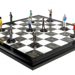 Chess board with people on depicting employment strategy